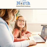 Happy Child with their homeschooling parent taking the Performance Series of Tests from True North Homeschool Academy.