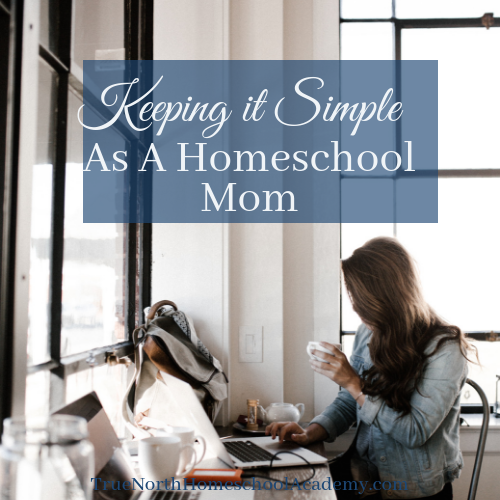 "Woman working at desk and drinking coffee with text ""Keeping it Simple As a Homeschool Mom"""