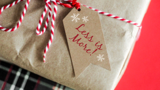 Simple brown paper wrapping on one gift with a tag that says less is more.