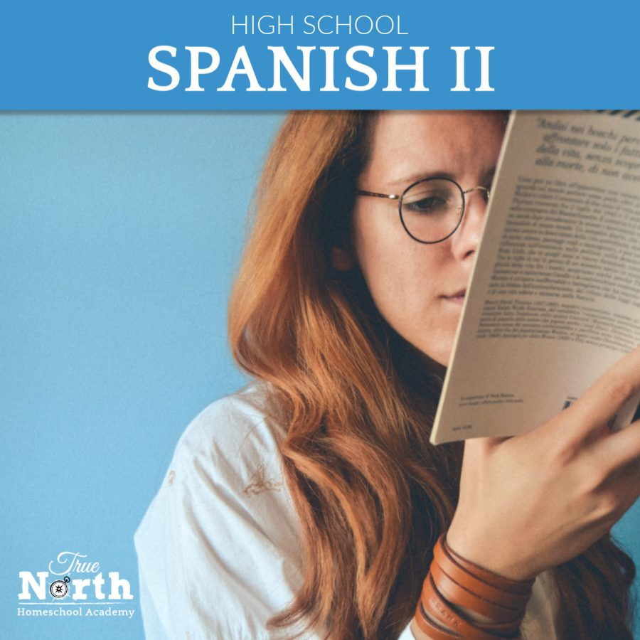 Online live classes for high school students of True North Homeschool Academy - Spanish 2 - Red Headed Girl Reading a Spanish Book