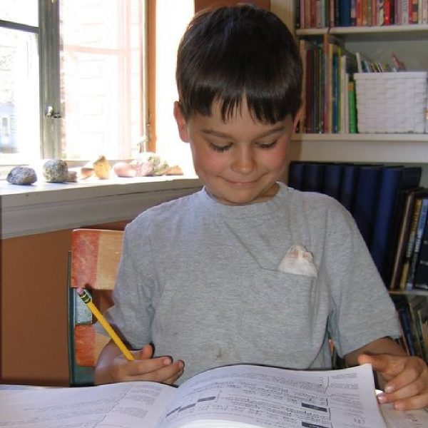Homeschool Student Theo Pool learns with a hamster in his pocket
