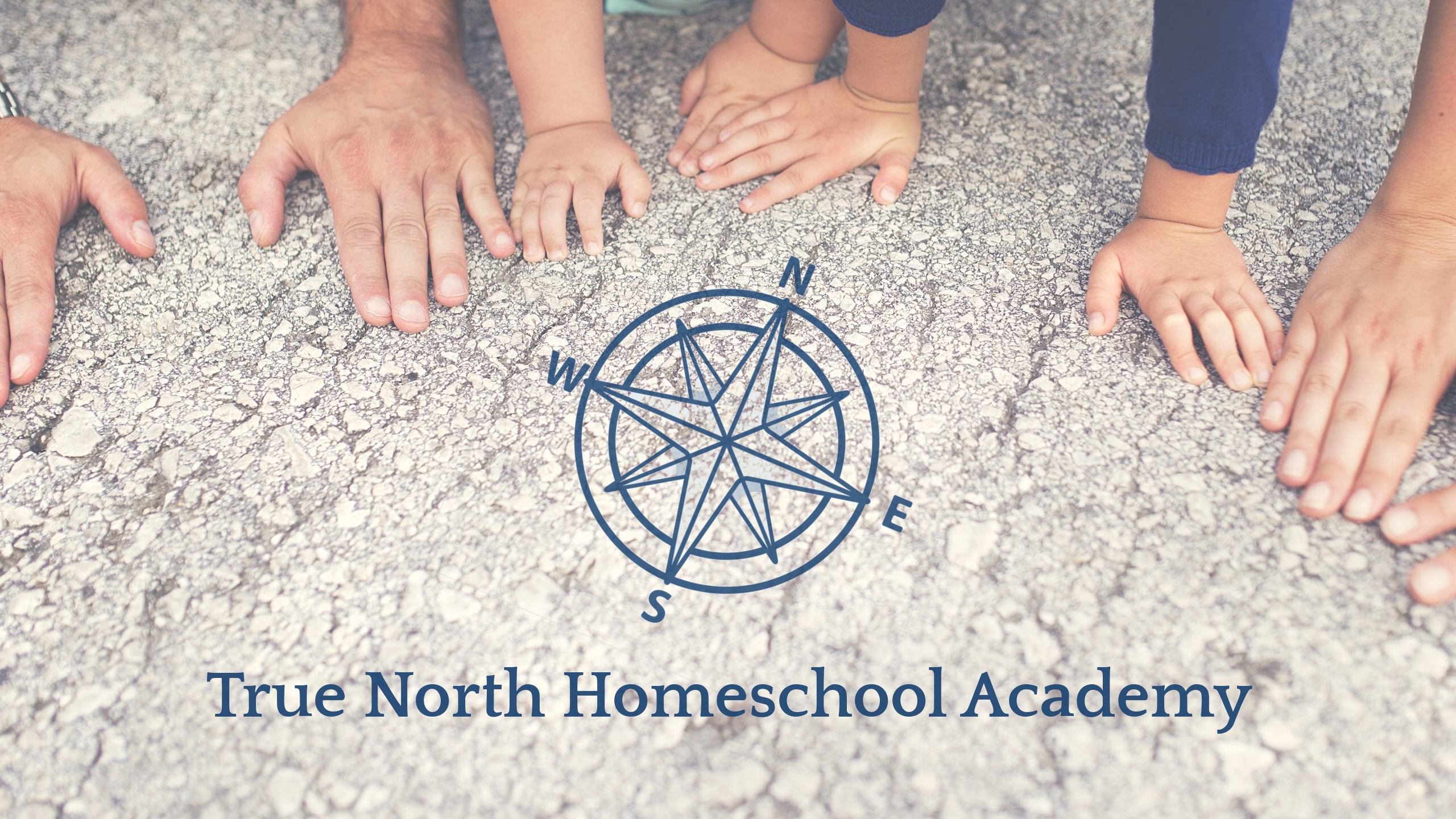 A Family's hands leaning on the ground with the True North Homeschool Academy Compass in the foreground.