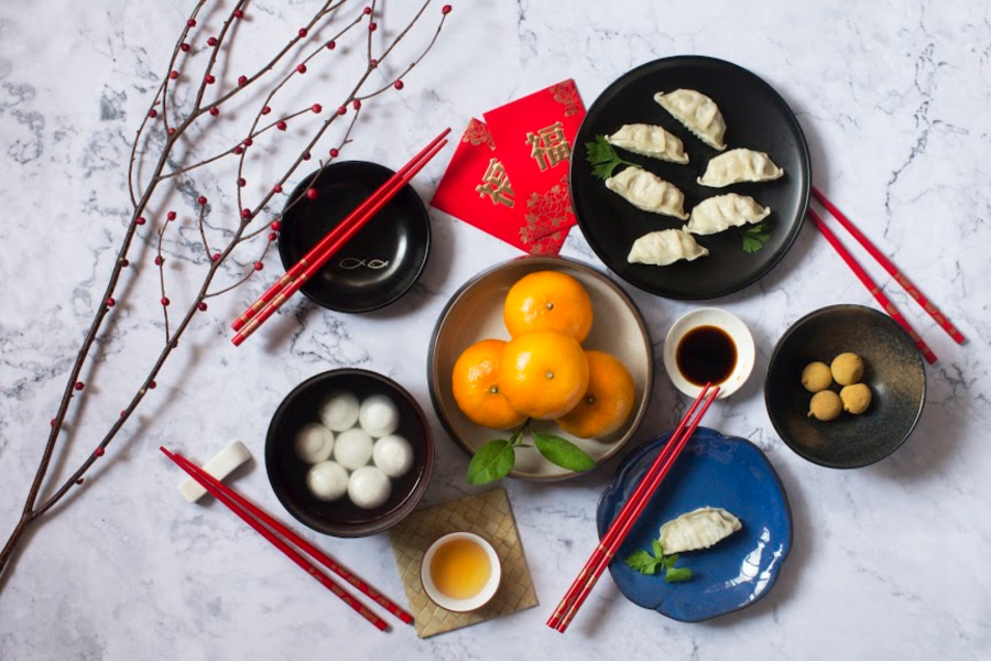 Flat lay Chinese new year food and drink reunion dinner on marble table top background.