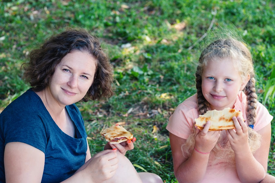 Homeschool mom and daughter having a picnic